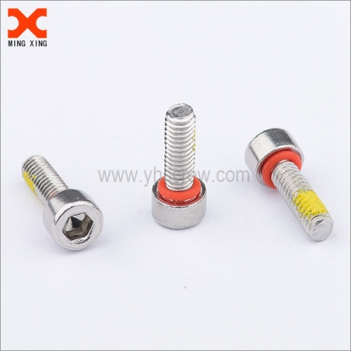 Self sealing screw socket cap DIN 912 yellow patch .